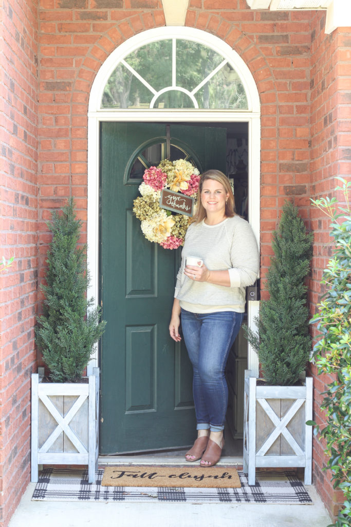 Cozy fall home tour with simple decor ideas for anyone on any budget! Hydrangea wreath, tall evergreen topiaries, fall-elujah doormat.