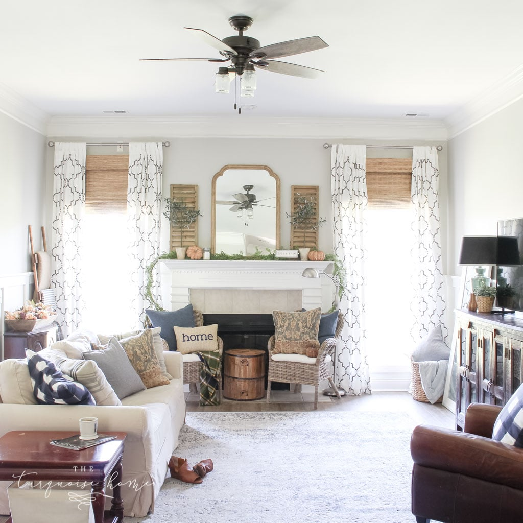 Beautiful blues and browns in this fall decorated living room. | Fall Mantel Decor Ideas | Fall Decor