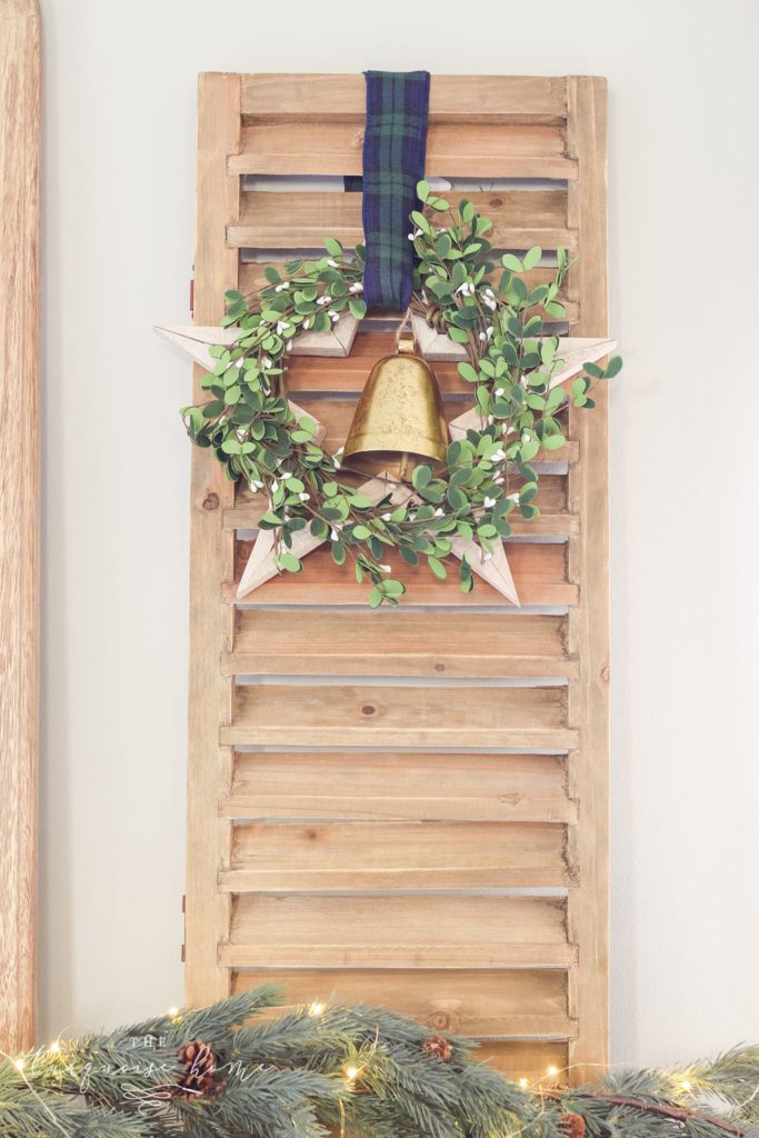 Green and Navy Simple Christmas Mantel - shutter with wooden star, wreath and bell.