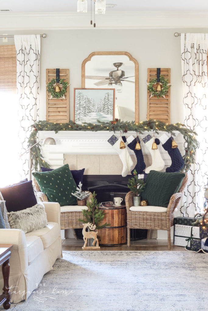 Green and Navy Simple Christmas Mantel - pretty gold bells, cable knit stockings and beautiful velvet pillows