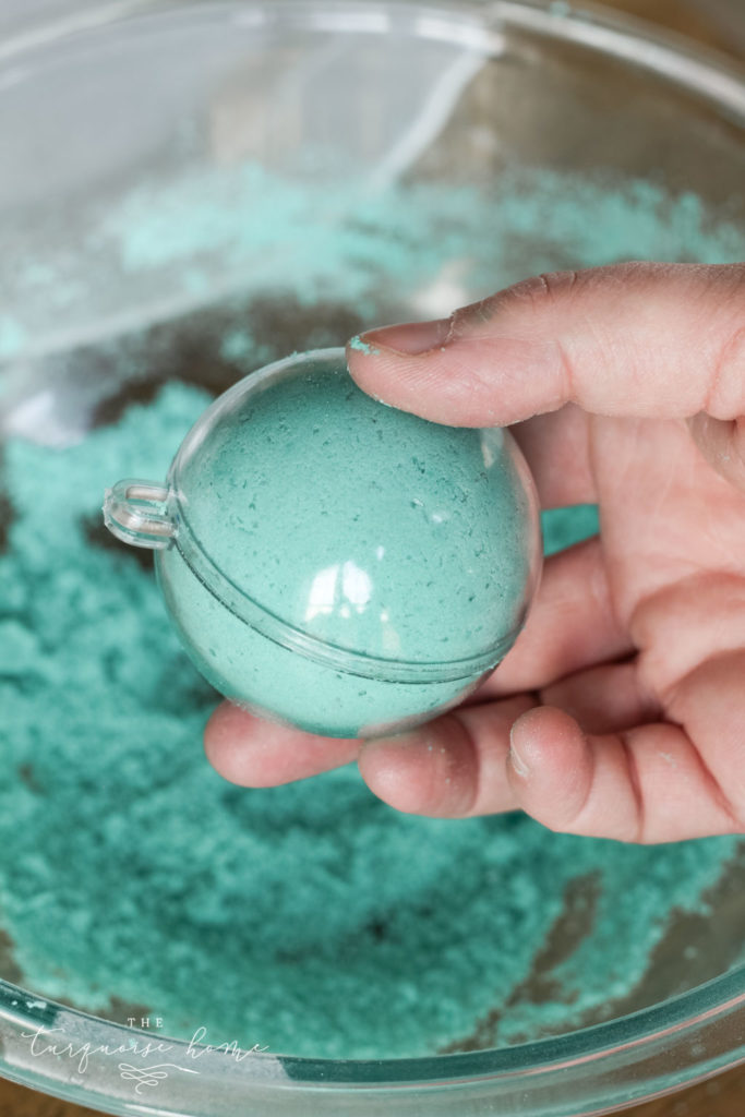 DIY Bath Bombs - add mixture to each side of the mold and then press them together